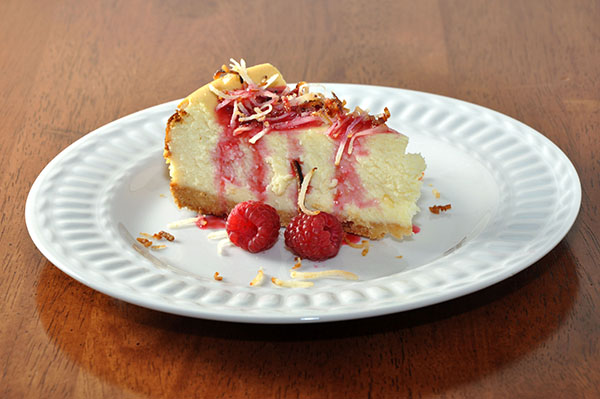 White Chocolate Coconut Cheesecake & Raspberry Whipped Cream Vodka Drizzle - inspirationkitchen.com