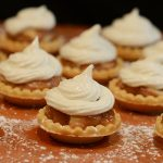 Caramel & Macadamia Nut Tarts with White Chocolate Buttercream Frosting