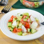 A fresh, light, and lowfat Tomato Cucumber and Onion Salad perfect for summertime picnics!